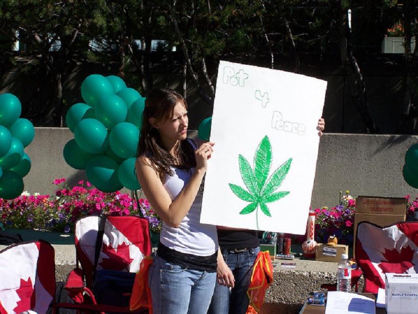 Top Marijuana Events. Women holding a pot 4 peace sign.