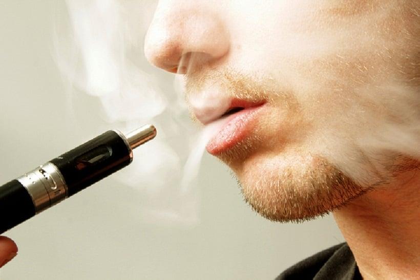 Top Marijuana Vape Pens. Man smoking a vape pen.