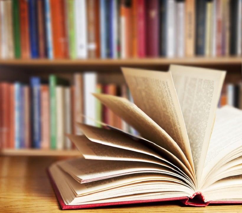 Top medical marijuana books. Book open on table.