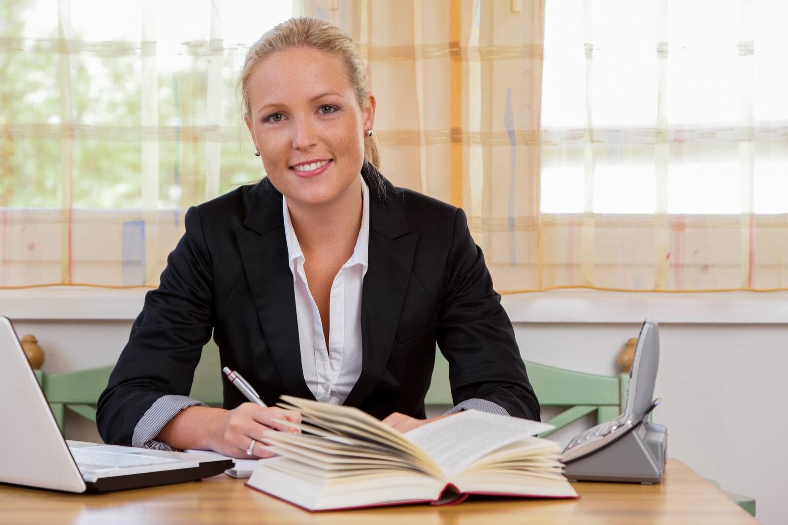 Top Ways Women Entrepreneurs Can Raise Marijuana Capital. Woman sitting at a work desk.
