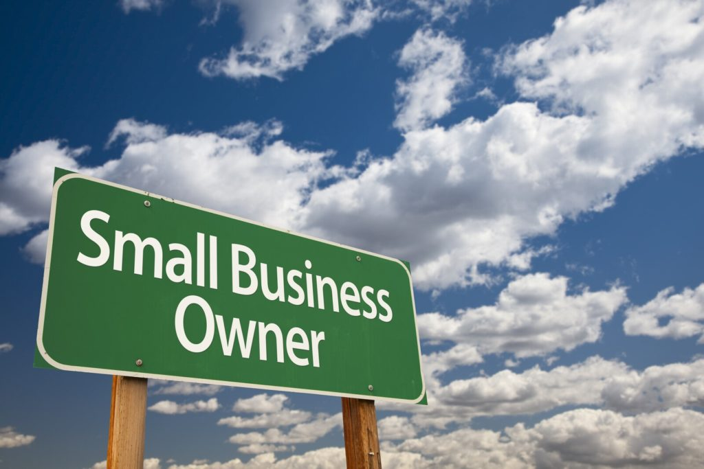 "How to Protect Yourself from Counterfeiting. ""Small Business Owner"" road sign."