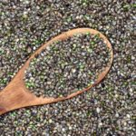 Benefits Of Hemp You Didn't Know About. Wooden Spoon in Pile of Hemp.
