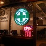 Curaleaf Sarasota Marijuana Dispensary Guide. Medical marijuana sign on store front.