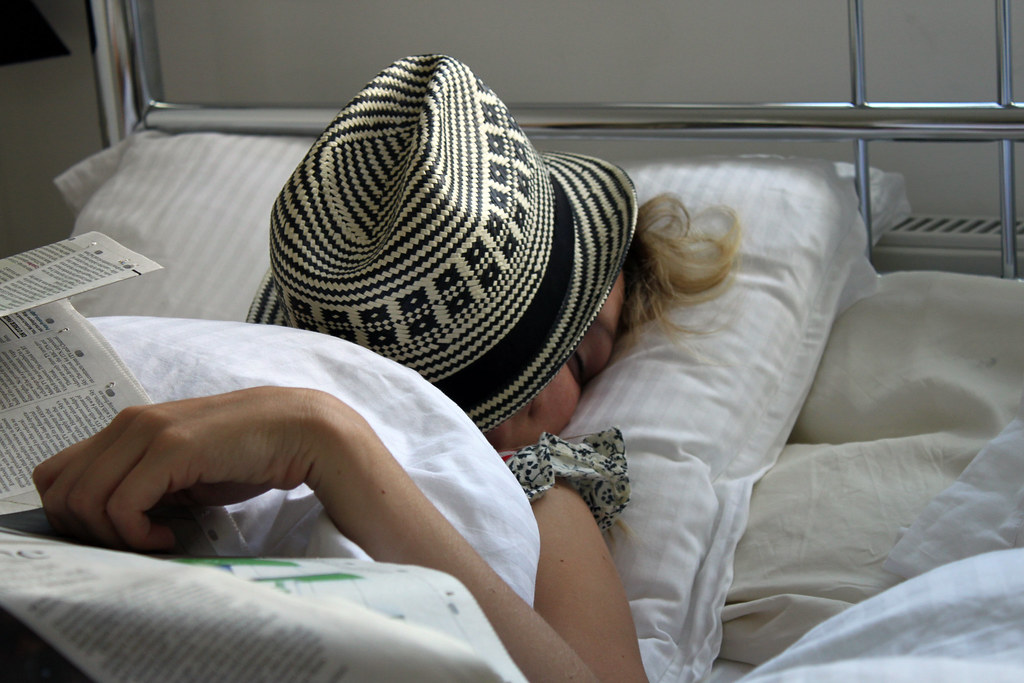 How to Get Rid Of A Cannabis Hangover? Lady in bed.