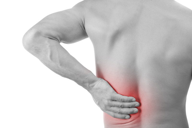 Man holding his back from pain
