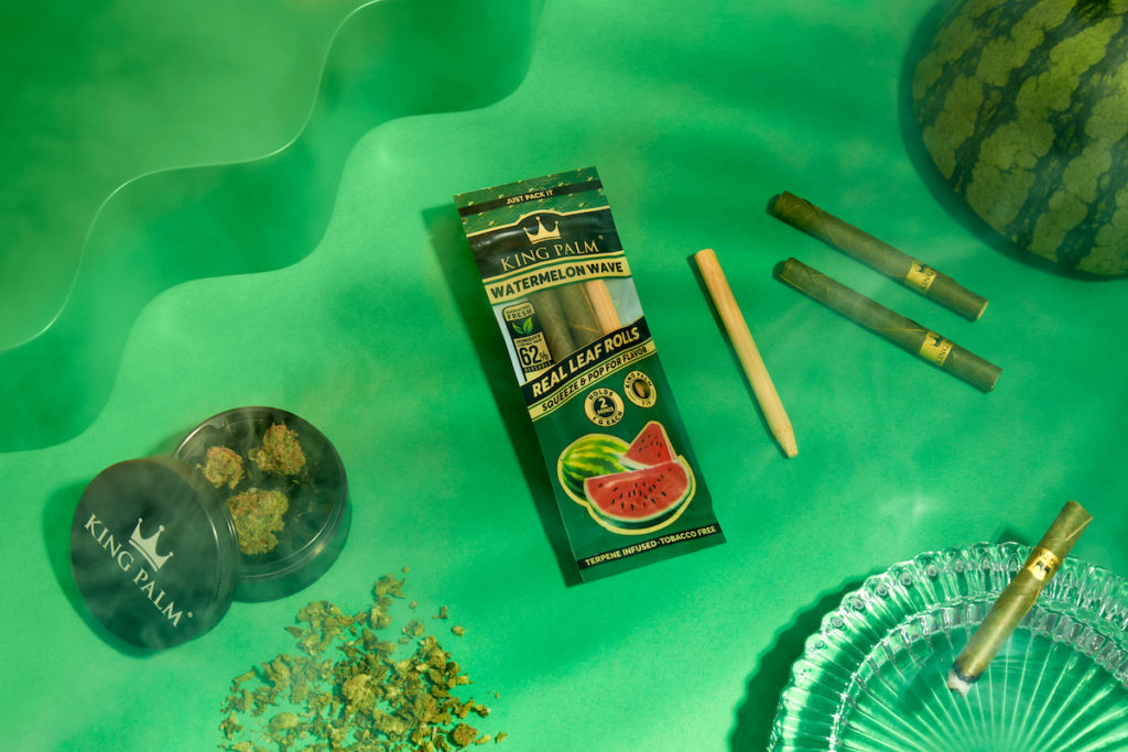 marijuana products on green surface, smoking cones