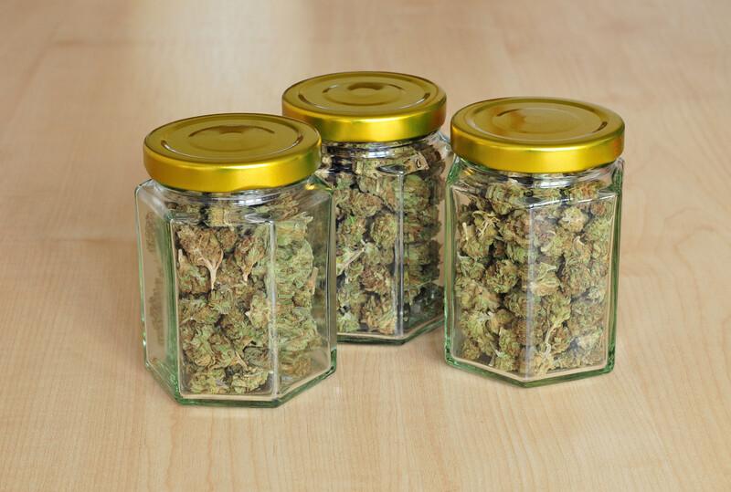 cannabis buds in glass jars, marijuana jars