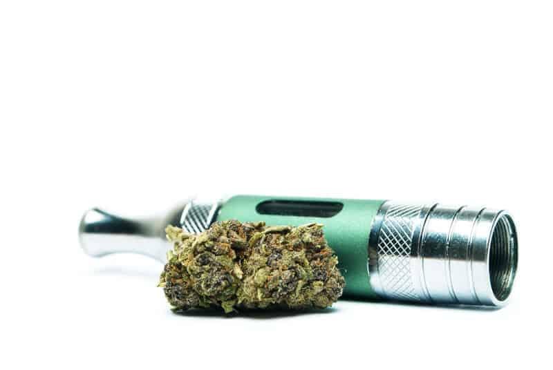 vape next to marijuana buds, consume marijuana